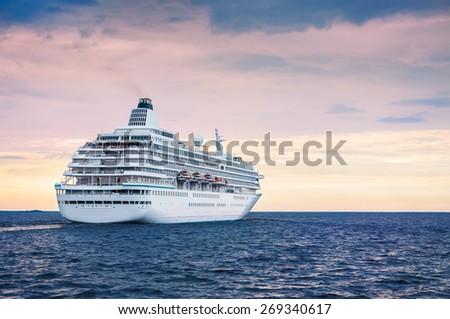 Big cruise ship in the sea at sunset. Beautiful seascape - stock photo