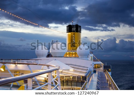 Big cruise ship riding in morning. - stock photo