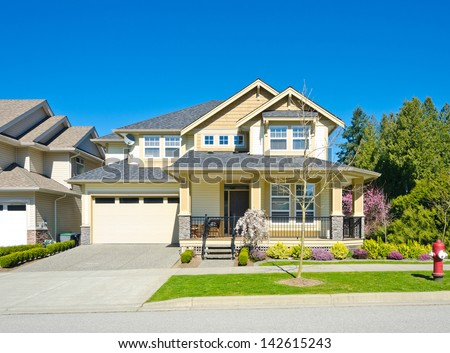 Big custom made cozy house with garage and driveway in the suburbs of Vancouver, Canada. - stock photo