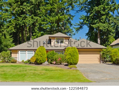 Big custom made double doors garage luxury house in the suburbs of Vancouver, Canada. - stock photo