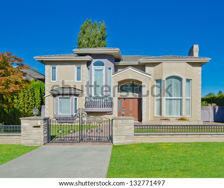 Big custom made luxury house behind the gates in the suburbs of Vancouver, Canada. - stock photo
