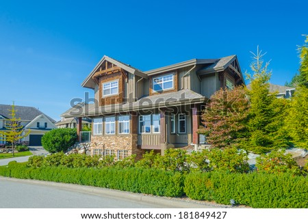 Big custom made luxury house on the empty street in the suburbs of Vancouver, Canada. - stock photo
