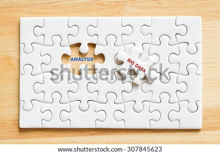 Big data and analysis words on jigsaw puzzle background, big data, technology and business concept - stock photo