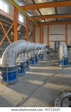 Big electric valve on a building site - stock photo