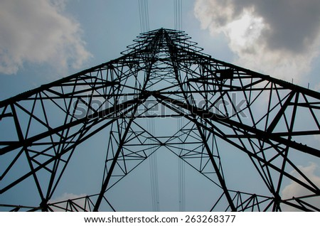 big electricity high voltage pylon and sky - stock photo