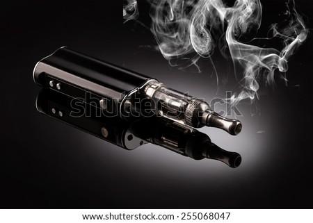 big electronic cigarettes isolated on black - stock photo