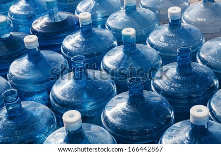 big empty water bottles in a row - stock photo