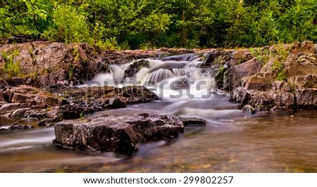 Big Eric's Falls. The falls is located north of Baraga, in a remote area of Michigan's Upper Peninsula. - stock photo