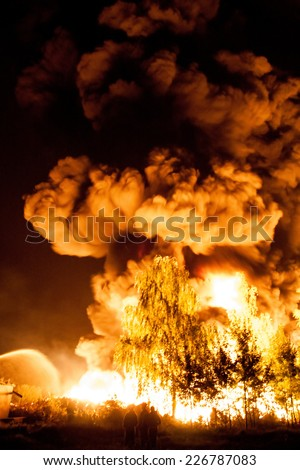 Big explosion with a lot of smoke and fire - stock photo