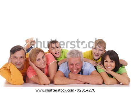 big family of a six lying on white background - stock photo