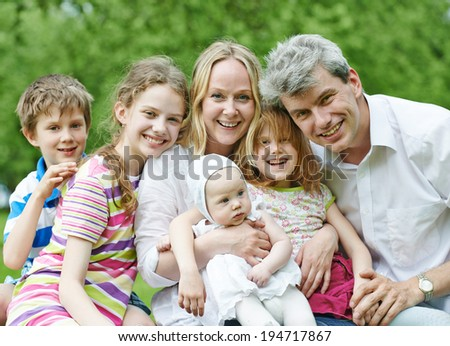 Big Family. Parents with four children in countryside outdoors - stock photo