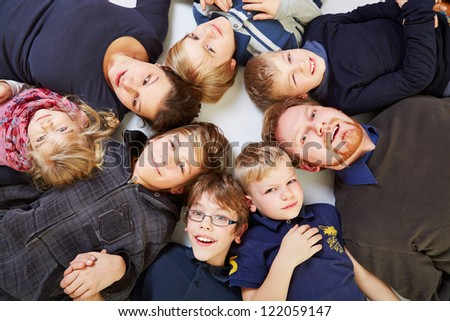 Big family with six kids in a circle looking up - stock photo