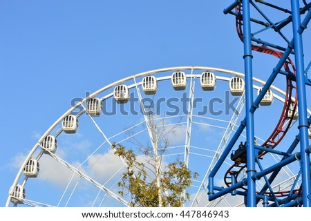 big Ferris wheel at an amusement park in the blue  sky, Russia - stock photo