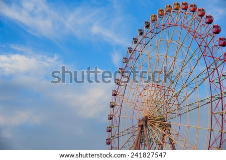 Big Ferris Wheel, Blue Sky - stock photo