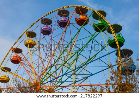 Big ferris wheel on cloudy sky - stock photo