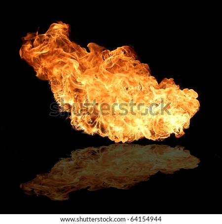 Big fire flame reflected on floor, isolated on black background - stock photo