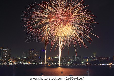 Big fireworks over the skyline of downtown Pattaya, Thailand - stock photo