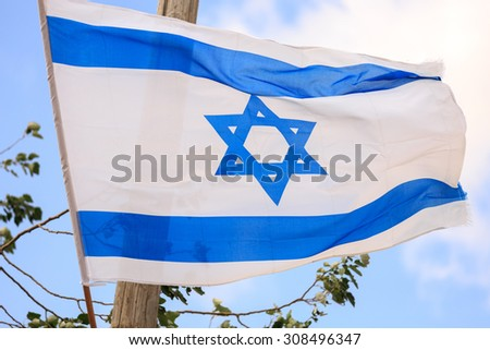 Big flag of Israel waving in the wind - stock photo