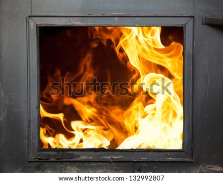 Big flames in the fireplace - incinerator - stock photo