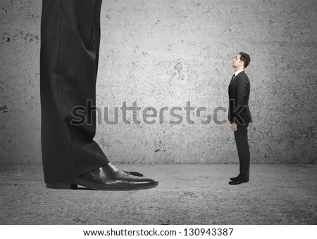 big foot and small  businessman - stock photo