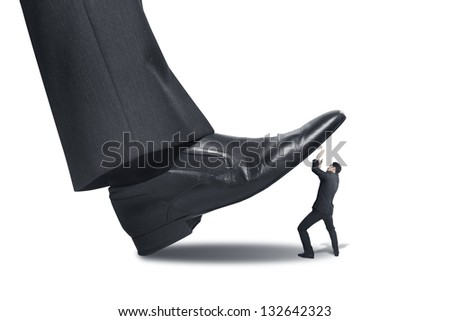 big foot stepping on businessman - stock photo