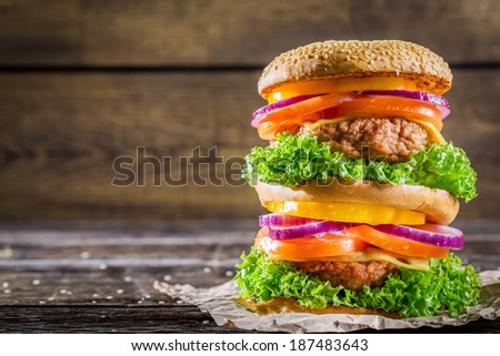 Big fresh and tasty homemade hamburger - stock photo