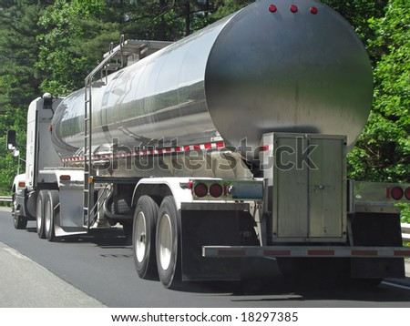 big fuel gas tanker truck on highway - stock photo