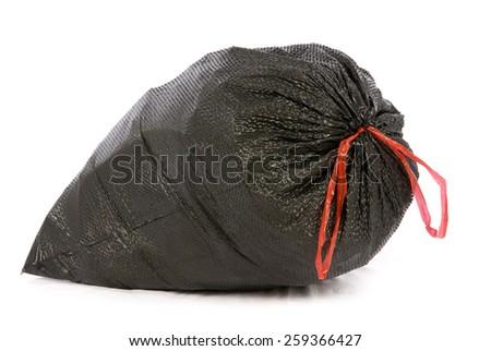 Big Full Black Garbage Bag Isolated On White - stock photo