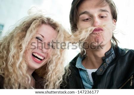 Big fun - couple playing with hair - stock photo