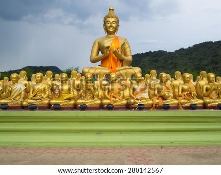 Big Golden Buddha and monk of buddha - stock photo