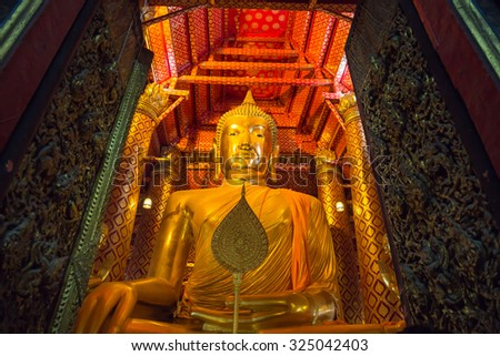 Big golden Buddha statue in temple at Wat Phanan Choeng Worawihan temple, Ayutthaya, Thailand, World Heritage - stock photo