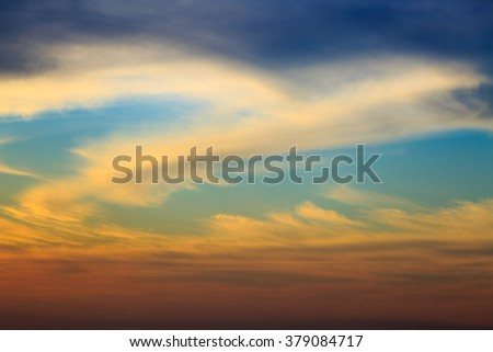Big golden clouds on sunset sky - stock photo