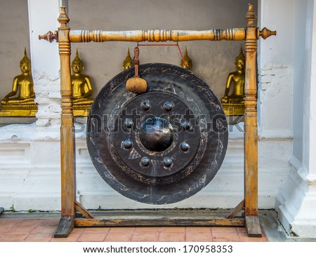 Big Gong hang on wooden column - stock photo