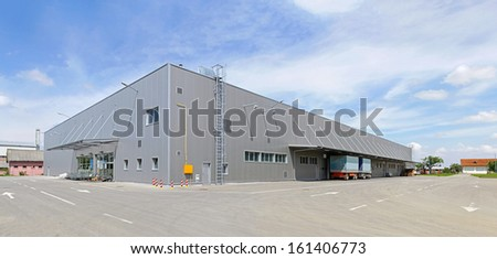 Big gray distribution warehouse building - stock photo