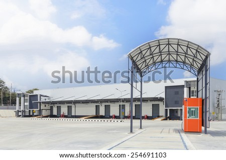 Big gray distribution warehouse building. - stock photo