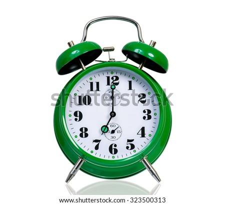 Big green alarm clock, isolated on white background - stock photo