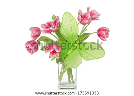 Big green paper butterfly and pink tulips in glass vase. - stock photo