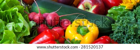 Big green zucchini with pepper, radish and lettuce in basket - stock photo