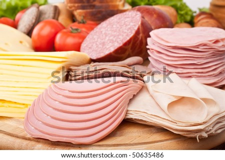 big group of meat, bread and vegetables - stock photo