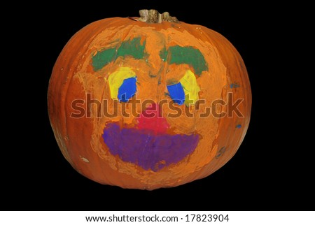 Big Halloween pumpkin painted with bright colors - stock photo