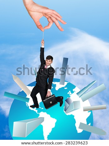 Big hand holding a cheerful business man - stock photo