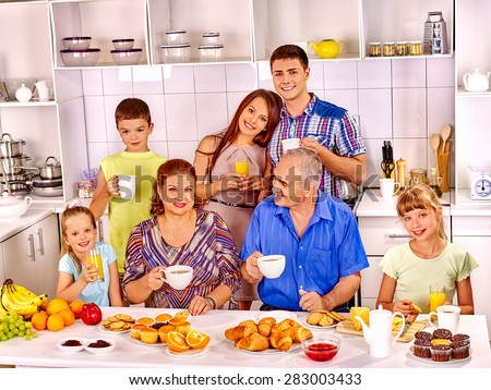 Big happy family have breakfast at kitchen. - stock photo