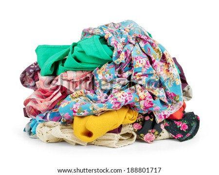 Big heap of colorful clothes,  isolated on white background. - stock photo