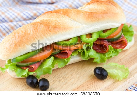 Big homemade sandwich with a lot of veggies - stock photo
