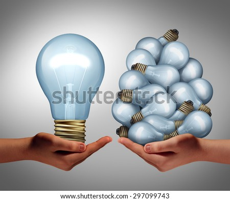 Big idea concept as a hand holding a large lghtbulb and another holding a group of small bulbs as a symbol of creativity and efficient creative leadership management or innovative inspiration leader. - stock photo