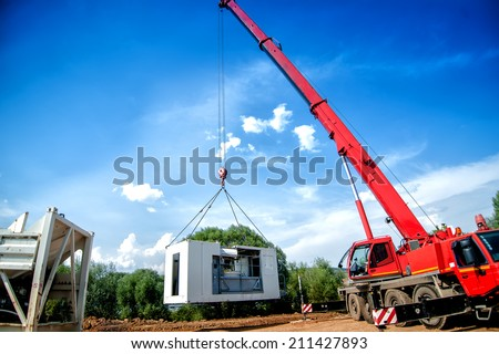 big, industrial crane moving a mobile cement plant - stock photo