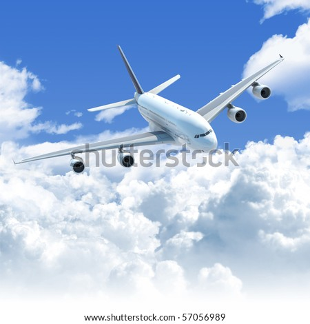 Big Jet airplane flying over a clear cloudscape seen from the top front, clipping path on the plane for easy isolation from the background - stock photo