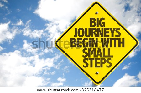 Big Journeys Begin With Small Steps sign with sky background - stock photo