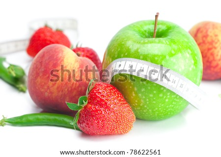 big juicy red ripe strawberries,apple,peas,peach and measure tape isolated on white - stock photo