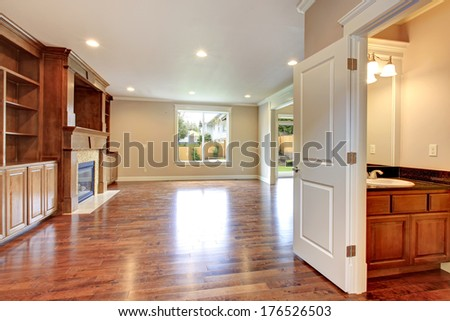 Big living room with storage combination and fireplace open to hallway and bathroom - stock photo